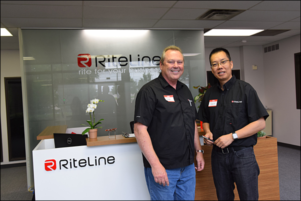 Steven Meyer, MAS, vice president of sales and marketing (left), and David Zheng, president, show off the new Riteline LLC facility in Dallas, Texas. The pen supplier opened its doors in Fall 2014.