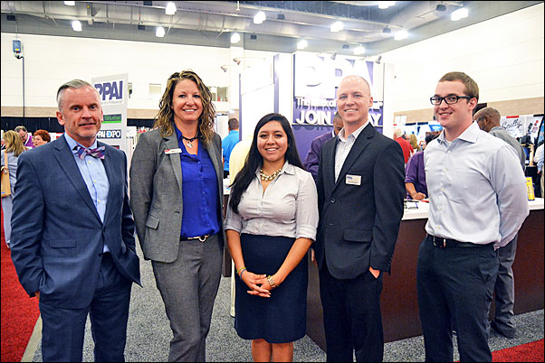(From left) Mark Jenkins, MAS+, Pioneer Balloons' managing director, promotional markets, and past-chair of the PPAI Board; Dana Floyd, director of information services for SAGE; and PPAI Government Relations Manager Seth Barnett joined Daniela Huerta (center) and Rand Barrett (right) from the office of Rep. Veasey for a tour of the SAGE Show trade show and to share with them the promotional products industry's story.