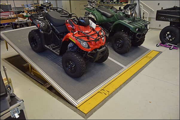 In the testing center's Outdoor Power Sports Lab, the CPSC uses a tilt table to test ATV parking brakes' ability to keep the vehicles stationary on a 30-percent grade.