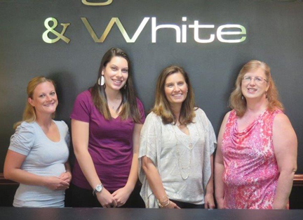 Nominators (from left) Kristina Watt, Kathleen Gubbels and Laura Spear (far right) credit their boss, Diane Kozel (second from right) and the trust she puts in them, for the company's ultimate success.