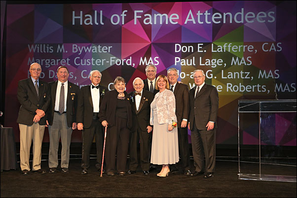 Lafferre (center) is joined on stage at the Expo's Chairman's Leadership Dinner with fellow inductees into the PPAI Hall of Fame.