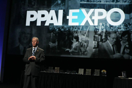 At the PPAI Expo 2012, Bruce Felber, MAS, prepares to introduce PPAI Chair of the Board Eric Ekstrand, MAS.