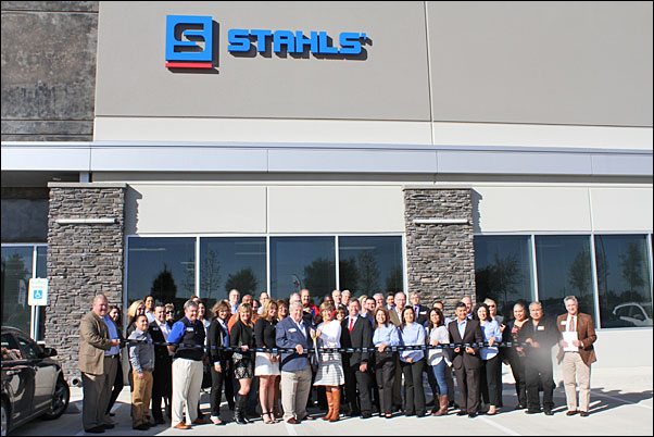 Stahls staff and guests join Executive Chairman of the Board Ted Stahl and his wife, Mary, for a ribbon cutting to open the supplier's Texas facility.
