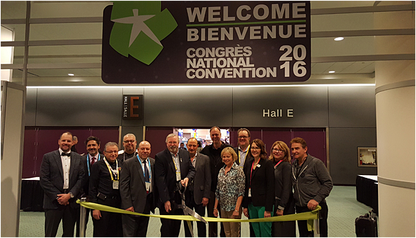 PPPC leadership and visiting dignitaries, including PPPC President Ed Ahad (fifth from left), PPAI Board Chair Tom Goos, MAS (far left), and PPAI President and CEO Paul Bellantone, CAE (second from left), opened the show with a ribbon cutting.