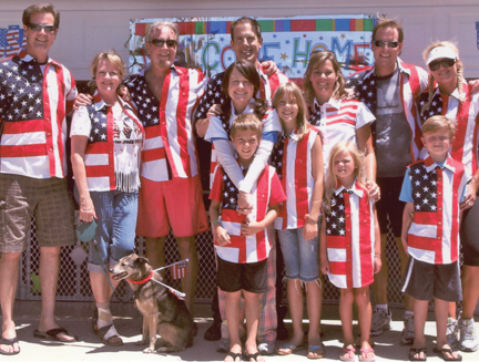Dan Scully (third from left), his wife, Laney (second from left), their sons Brian (left), Dan IV (third from right) and Kevin (fourth from left) and their families celebrate the Fourth of July in Scully shirts from the company's Patriot collection.