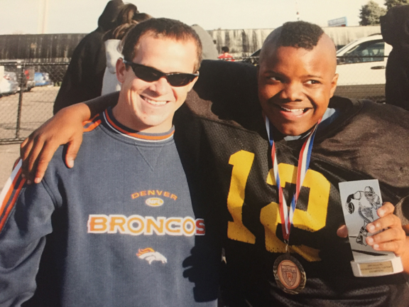 Kaspari (left) and his mentee, Noah Jones, then a sixth-grade football player.
