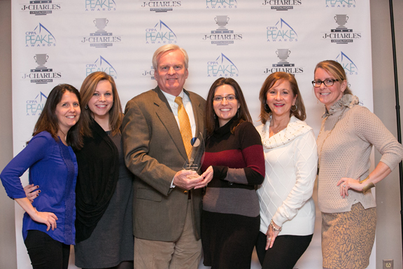 Target Marketing Group President and Founder John Leahy (center) attends the CPPA 2016 Peake Awards with members of his company's team to accept the Distributor of the Year award.