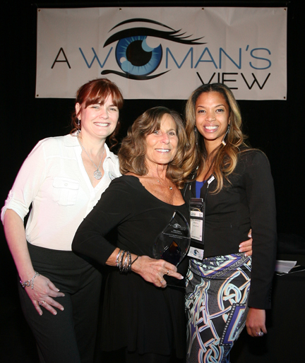 Tayla Carpenter (right) and Candace Plunkett (left), A Woman's View program managers, presented Ellen Orne of Ellco Promotions with the 2016 A Woman's View Visionary Award in appreciation of her strength and commitment to the industry and in recognition of her dedication, professionalism and success.