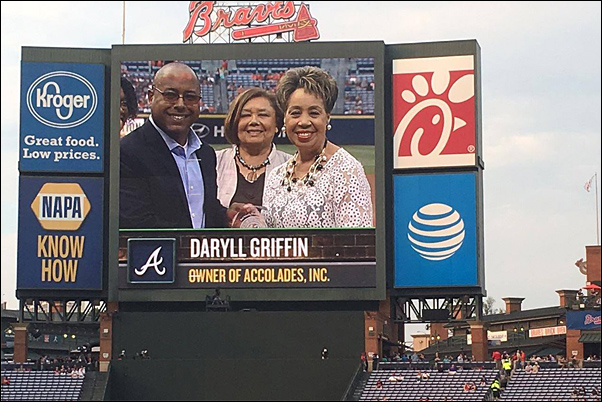 Accolades CEO and Founder Daryll Griffin, MAS (right), accepting the Jackie Robinson Most Valuable Diverse Business Partner Award on behalf of her company.