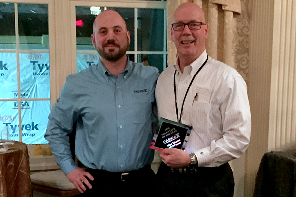 Mike Valentini, Sr., accepts the regional association's Volunteer of the Year award from his son, Mike Valentini, Jr.