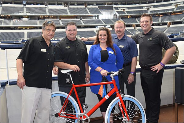 MLR Alliance's Tony Pinto, Tony Tuso, Julia McDonald-Ward, Bill Reisack and Drew Ward show off the Solé bicycle given away in a drawing at the May 11 event.