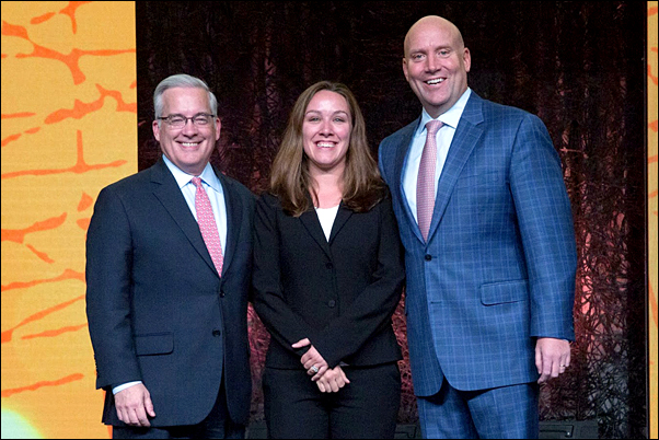 Sarah Thomas; director of vertical markets at ASB (center) accepted the award at Premier's 2016 Breakthroughs Conference and Exhibition from Durral Gilbert, president of supply chain services for Premier (left) and Mike Alkire, Premier's chief operating officer.