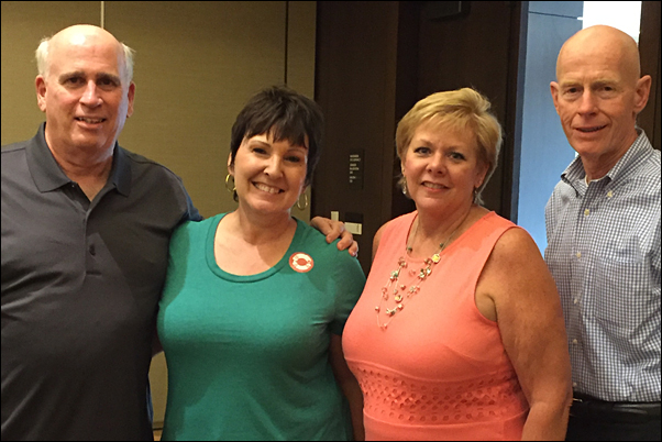 From left are John Mika, director of The Teacher's Desk; Lesley Walton, manager of gift-in-kind and volunteer coordinator, KINF; Carol Gauger, MAS, and Dave Smith, executive director, KINF.