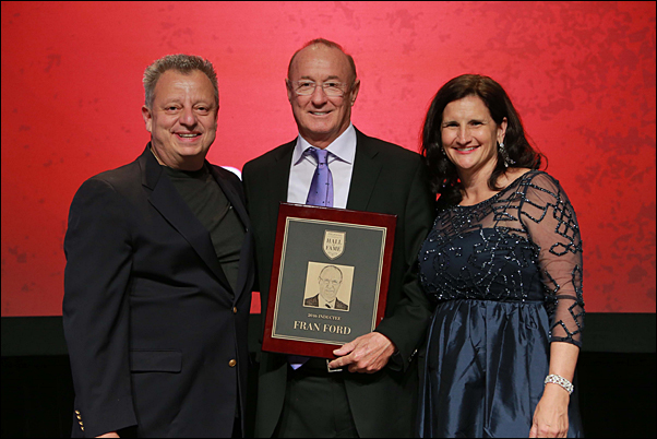 Fran Ford (center), receives a plaque marking his induction into the Proforma Hall of Fame, with Founder Greg Muzzillo and CEO Vera Muzzillo