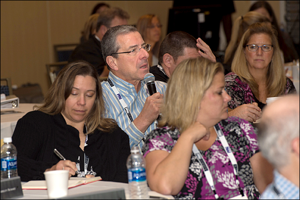 Summit Co-chair Gene Geiger comments during a session.