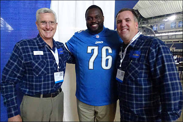 MiPPA Immediate Past President Dave DeWitt and President-Elect Paul Zafarana pose with Scott Conover, Detroit Lions offensive tackle, 1991-1996