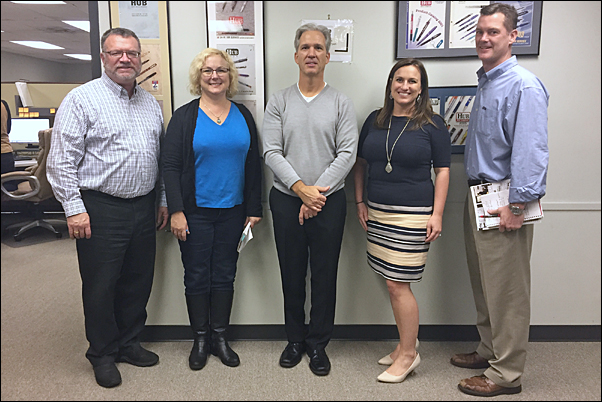 Cutline: Tucker (second from right) and Baker (center) got an up-close look at Hub Pen's Braintree, Massachusetts, facility and the supplier's laser technology during their meeting with Executive Assistant and Marketing Copywriter Pam Baker (second from left); National Sales Manager Andy Arruda, MAS (left); and Vice President of Sales Mike Fleming.