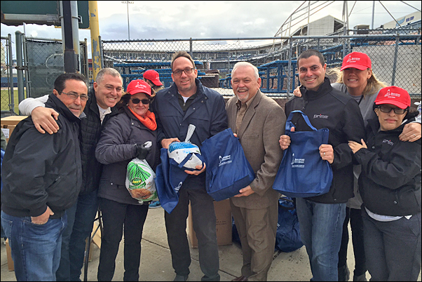 Prime Line CEO Jeff Lederer (center left) and staff members join Bridgeport Rescue Mission Executive Director Terry Wilcox (center right) at the BRM's Great Thanksgiving Project.