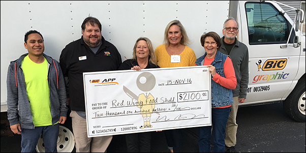 BIC Graphic associates delivered the food and funds collected on November 15.