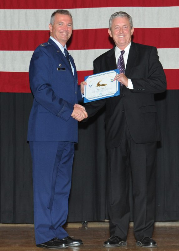 Wayne Roberts, right, receives the Golden Eagle award from Col. Ricky Rupp at McConnell Air Force Base in Kansas.
