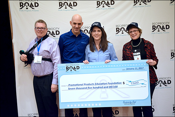 Reciprocity Road's Rod Brown, MAS, president of MadeToOrder (left) and Jeremy Lott, SanMar, present a check for PPEF to Sara Besly, PPEF Foundation manager and Pat Dugan, MAS, PPEF chair, during The PPAI Expo.