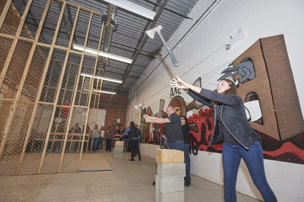 Attendees take the opportunity to unwind at the National Convention's axe-throwing party, sponsored by the PPPC Board of Directors and BIC Graphic.
