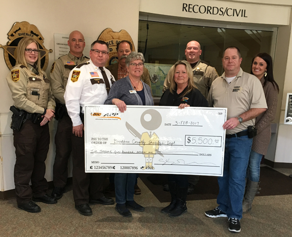 Deb Fleming, Linda Huppert (holding the check) and Cassie Otto of BIC Graphic Red Wing visited the Goodhue County Sheriff's Office to present them with the donation on February 2.